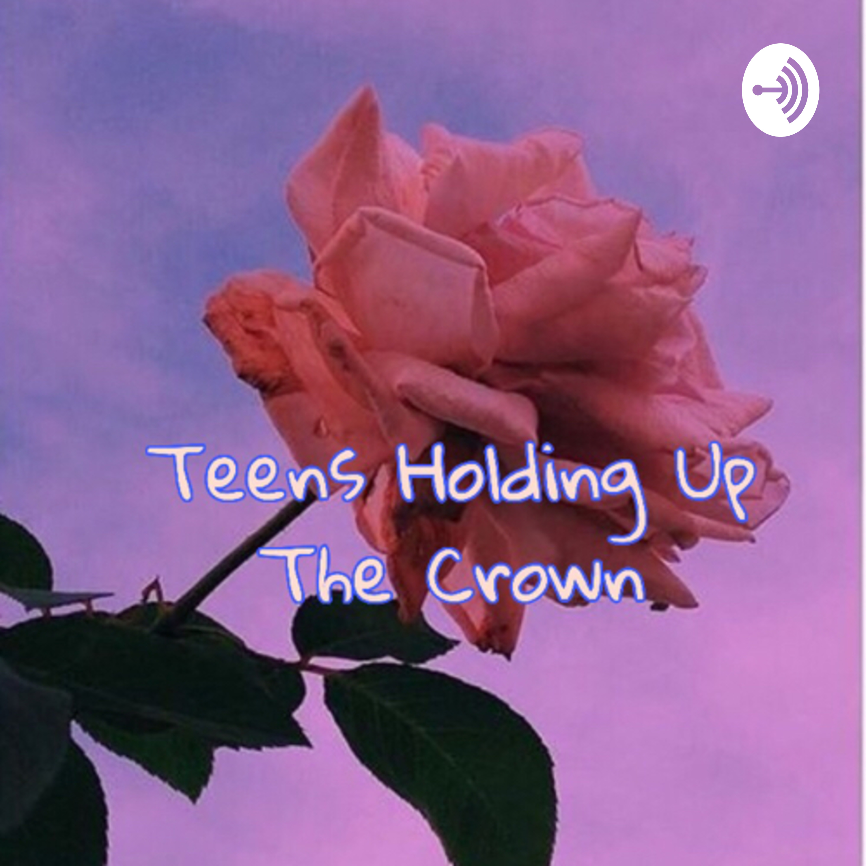 Teens holding up the crown