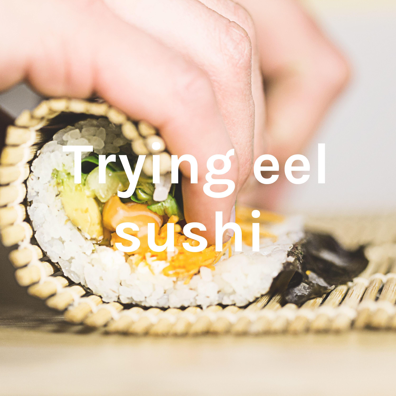 Trying eel sushi