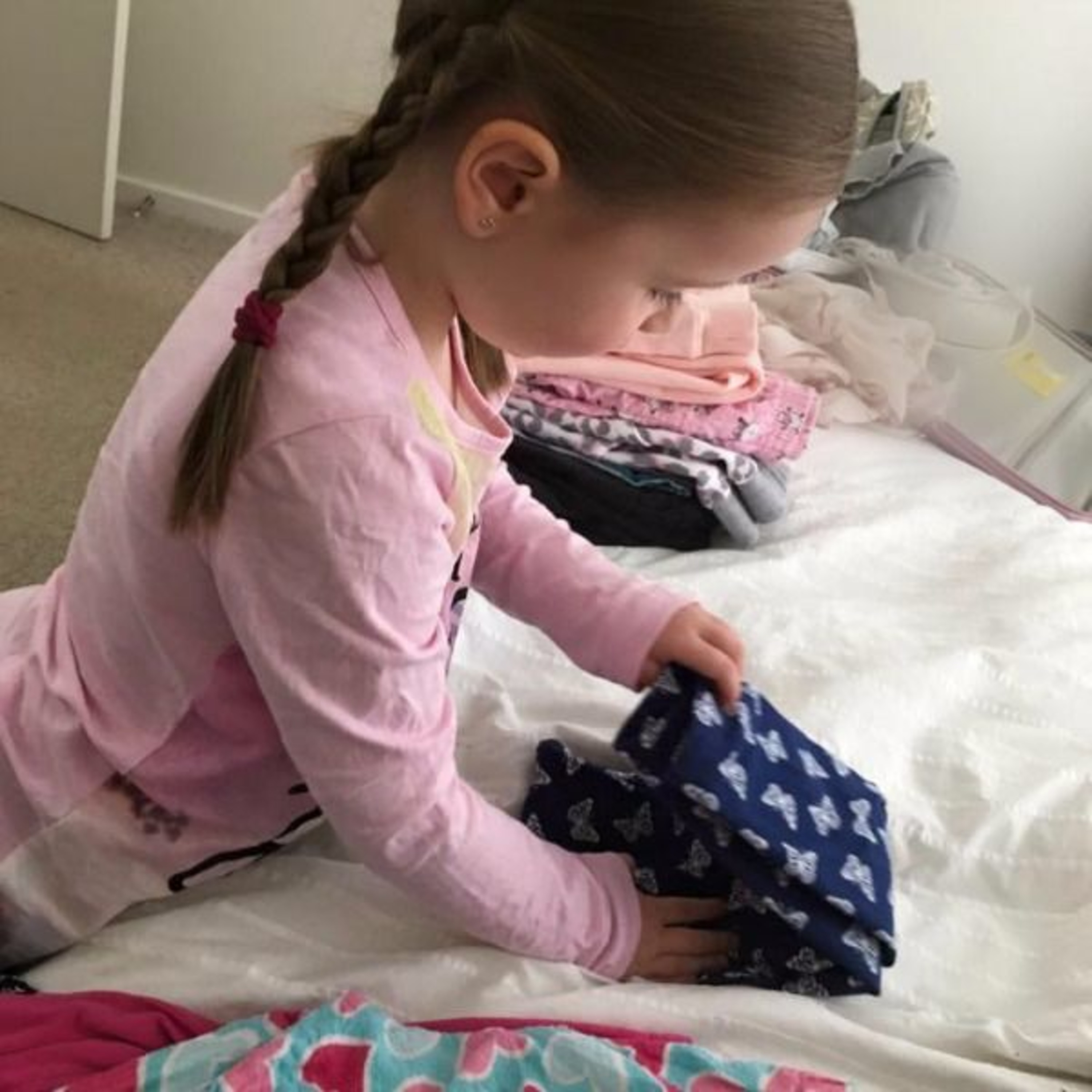 How to encourage young children to help around the house (folding laundry)